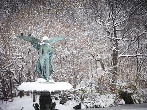 Angel of the Waters Fountain in Central Park after a Snow Storm by Keith Barraclough