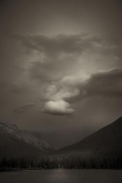View at Dusk of Mountains with Storm Clouds Surrounding at Vermillion Lakes in Banff, Canada by Keith Barraclough