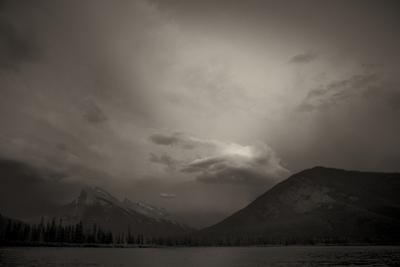 View of Mount Rundle at Dusk with Storm Clouds from Vermillion Lakes in Banff, Canada by Keith Barraclough