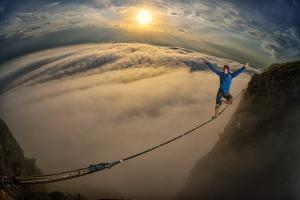 A Coastal Front Blows in While a Highliner Traverses Two Cliffs Above Rio De Janeiro by Keith Ladzinski