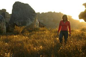 A Female Climber Walking at Sunset in the Cederberg Wilderness Area, South Africa by Keith Ladzinski