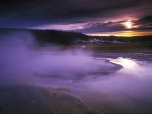 A Geyser at Twilight in Yellowstone National Park, Wyoming by Keith Ladzinski