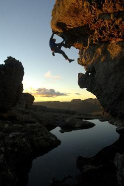 A Man Bouldering in the Cederberg Wilderness Area, South Africa by Keith Ladzinski