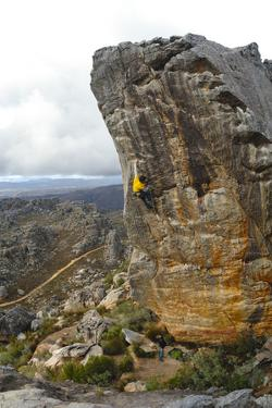 A Man Climbs a Boulder in the Cederberg Wilderness Area While His Partner Waits at the Bottom by Keith Ladzinski