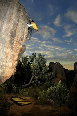 A Man Climbs a Rock in the Cederberg Wilderness Area, South Africa by Keith Ladzinski