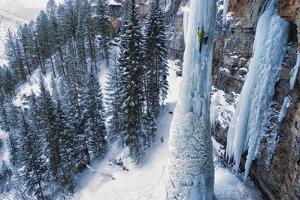 A Man Ice-Climbing by Keith Ladzinski