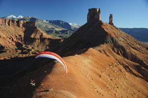 A Man Parachutes after Base Jumping from the Fisher Towers by Keith Ladzinski