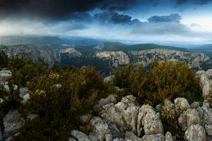 A Panoramic View from a Rocky Rim of Verdon Gorge under Dark Clouds by Keith Ladzinski