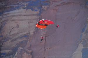 A Person Parachutes after Base Jumping Off a Desert Spire at the Fisher Towers by Keith Ladzinski