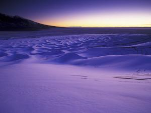A Rarely Seen View of Snow-Covered Sand Dunes, at Twilight by Keith Ladzinski