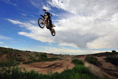 A Rider Jumps High in the Air at a Motocross Event by Keith Ladzinski