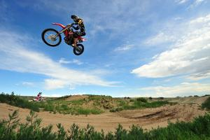 A Rider Sails Through the Air at a Motocross Event by Keith Ladzinski