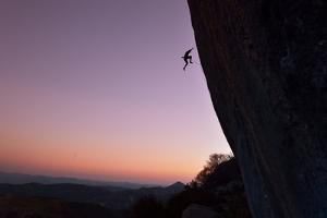 A Rock Climber Falls from the Side of Ceuse at Sunset by Keith Ladzinski