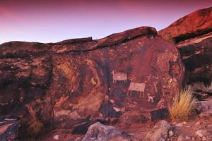 A Rock Covered in Petroglyphs at Sunset by Keith Ladzinski