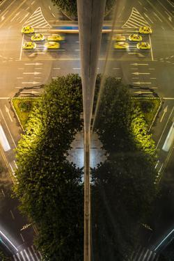 A Street Scene Reflected in the Glass of a Building by Keith Ladzinski