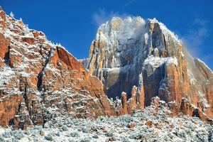 A Winter Sunrise with a Snowy Landscape in Zion National Park by Keith Ladzinski