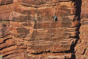 A Woman Climbs at the Fisher Towers by Keith Ladzinski