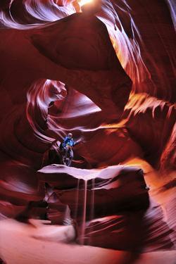 A Woman Exploring Antelope Canyon by Keith Ladzinski