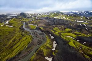 An Aerial of a Rolling Green Landscape and Streams of Glacier Runoff at Southern Iceland by Keith Ladzinski