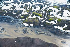 An Aerial of Snowcapped Mountains and Streams of Glacier Runoff in of Southern Iceland by Keith Ladzinski