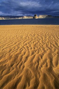 Desolate Wind-Blown Sand and Beach of Lake Powell at Page, Arizona by Keith Ladzinski