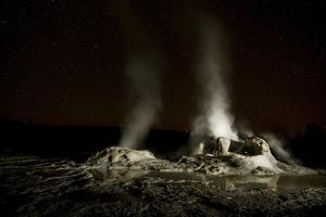 Grotto Geyser Steams under a Star-Filled Sky in Yellowstone National Park by Keith Ladzinski