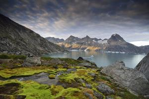 Moss-Covered Stones on a Mountainous Fjord Coast at Sunset by Keith Ladzinski