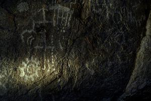 Petroglyphs on a Rock Wall in Arrow Canyon by Keith Ladzinski