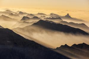 Smoke from Wildfires Shroud the Peaks of the Northern Rockies by Keith Ladzinski