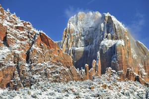 Snow on Rock Formations and Desert Landscape by Keith Ladzinski