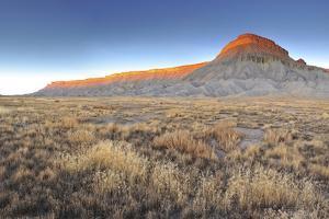 Sunlight on Mount Garfield, and the Surrounding Desert Landscape by Keith Ladzinski