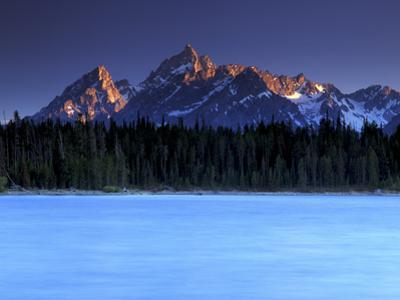 Sunset on the Teton Range, from a Crystal Clear Jackson Lake in Grand Teton National Park by Keith Ladzinski