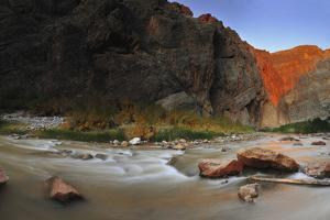 The Virgin River Rushing Past Sunlit Cliffs by Keith Ladzinski