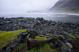 The Wreck of a Boat Rests on Stokeness Beach in Hofn, Iceland by Keith Ladzinski