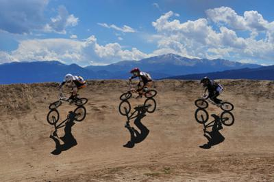 Three Riders Race Single File at a Bmx Race by Keith Ladzinski
