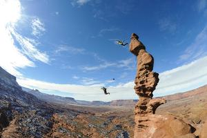 Two People Base Jump Off a Sandstone Spire at the Fisher Towers in Castle Valley, Utah by Keith Ladzinski