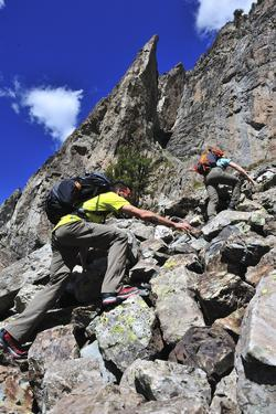Two People Scramble Up a Scree Slope to Climb Crystal Tower by Keith Ladzinski