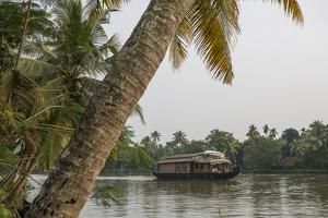 A Houseboat Carries Locals and Tourists Through the Backwaters by Kelley Miller