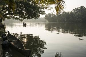 A Man Rows His Canoe Early in the Morning by Kelley Miller