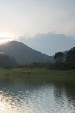 A View from Periyar Lake of the Sun Setting Behind Cardamom Hills by Kelley Miller