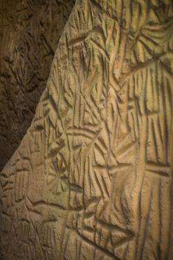 Ancient Rock Carvings Depict Human Figures by Kelley Miller