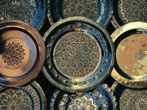 Close-up of Copper Trays for Sale, Morocco, Africa by Ken Gillham