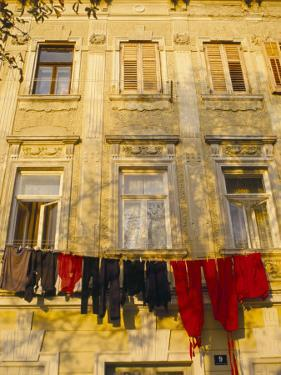 Washing Line of Colourful Laundry in Old Town Buzet, Hilltop Village, Buzet, Istria, Croatia by Ken Gillham