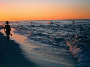 Woman Walking on the Beach Into the Sunset, FL by Ken Glaser