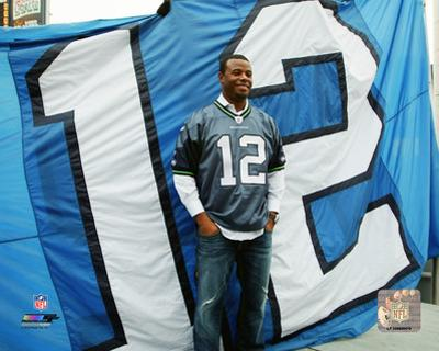 Ken Griffey Jr. with the 12th man flag at Centurylink Field in Seattle