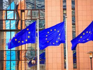 Belgium, Brussels; Three Flags Carrying the European Union Emblem in Front of the E;U Headquarters by Ken Sciclina