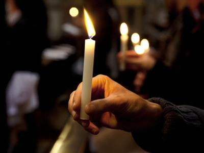 Sicily, Italy, Western Europe, a Believer, Holding a Candle During the Easter Eve Ceremony at the T by Ken Scicluna