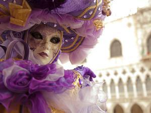 Venice, Veneto, Italy, a Masked Character in Front of the 'Palazzo Dei Dogi' During Carnival by Ken Scicluna