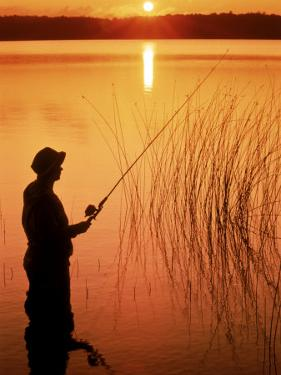 Silhouette of Man Fishing, Vilas City, WI by Ken Wardius