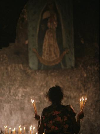 A Mexican Woman Prays to the Virgin Mary During a Religious Ceremony by Kenneth Garrett